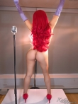 Длинноногая без в красном платье опускается на корточки показывая горячую письку, фото 13